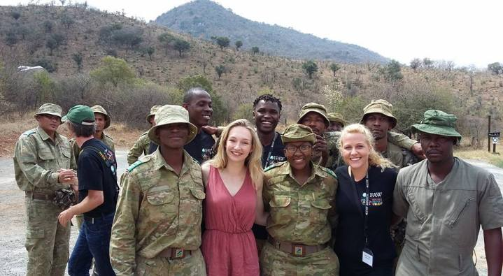 Youth delegates Olivia and Josephine Crouch stand next to Reginah Mogwera, head ranger for the anti-rhino poaching unit a.k.a. Brave-ass-hero!